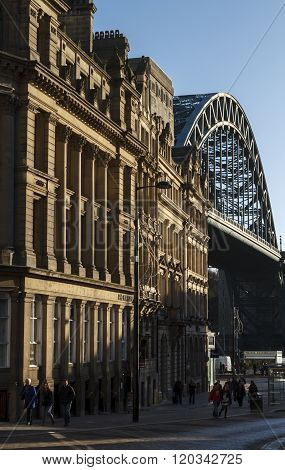 NEWCASTLE ENGLAND - DECEMBER 7 2014: Sandhill lane with its historic old limestone buildings and the Tyne Bridge in the background.