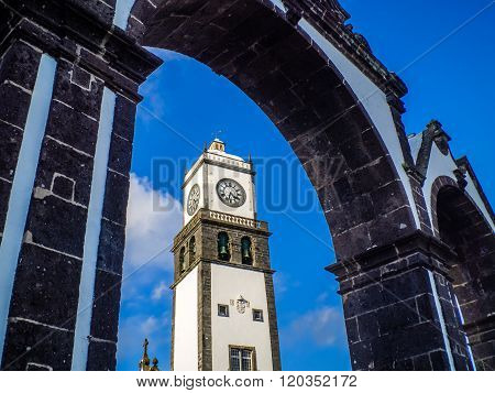 Famous arched monument Portas de Cidade and the tower of theIgreja Matriz de Sao Sebastiao church in Ponta Delgada, Sao Miguel, Azores, Portugal. ** Note: Visible grain at 100%, best at smaller sizes