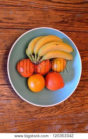 Bananas, Valencia Oranges And Tangelos In Large Blue Bowl