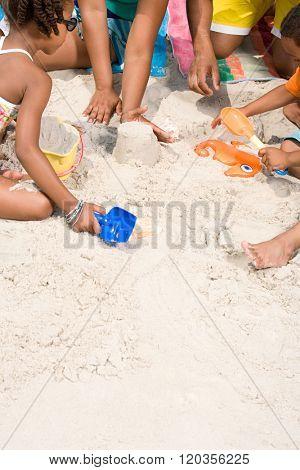 Family making sandcastles