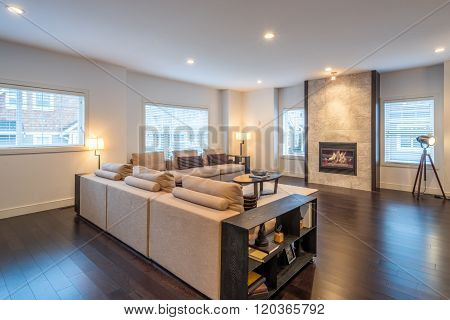 Spacious bright living room with fireplace in luxury house. Interior design.