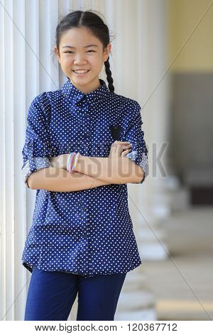 Portrait Of Thai 12S Years Girl Wearing Blue Shirt Standing Out Door With Toothy Smiling Face Happin
