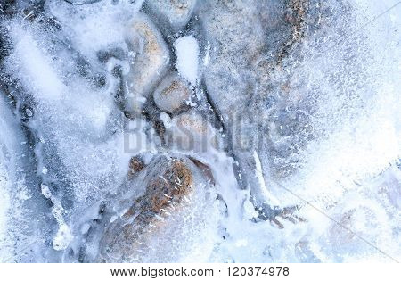 transparent ice with air bubbles and stones