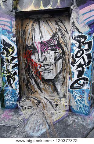 Mural art by artist Sarah Masson at Hosier lane in Melbourne