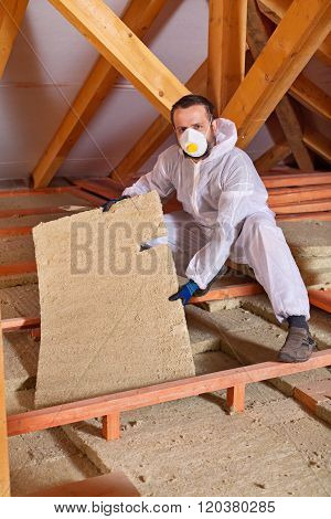 Man Installing Thermal Isnulation With Mineral Whool Panels