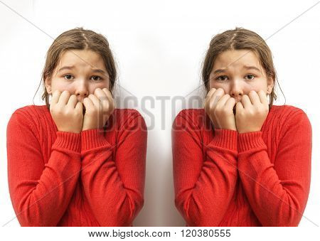Portrait two young little girls biting her finger nails, looking at you with fear of something, anxious isolated