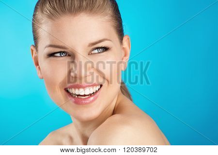 Smiling female over blue