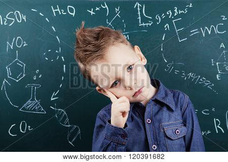 Little Boy Near Blackboard With Formulas