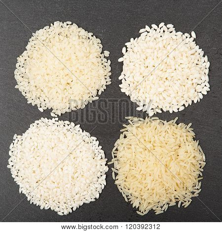 Various Color And Shape Varieties Of Rice On Black Slate Tray