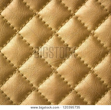Golden Genuine Leather Upholstery Texture or Background