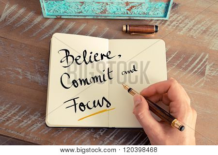 Handwritten Text Believe, Commit And Focus