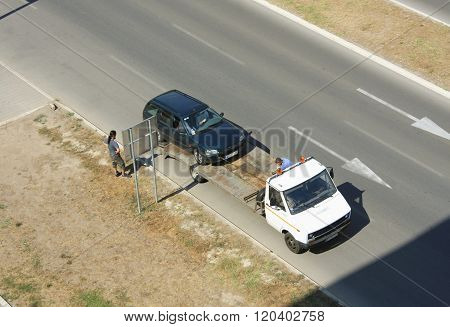 Man towing damaged car