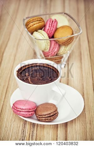 Cup Of Black Coffee With French Colorful Macarons