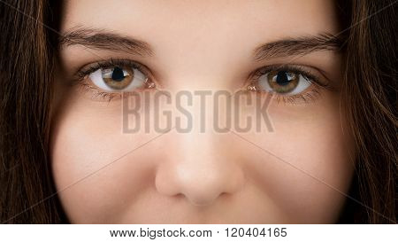 closeup portrait of young woman with hazel eyes