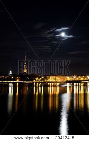 Night panorama of Riga, Latvia with the President's Palace and Old City reflecting in Daugava River