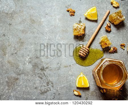 Honey Background. Natural Honey With Slices Of Lemon And Walnuts.
