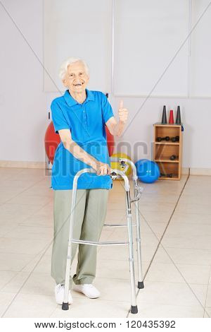 Old happy woman with walker holding her thumbs up