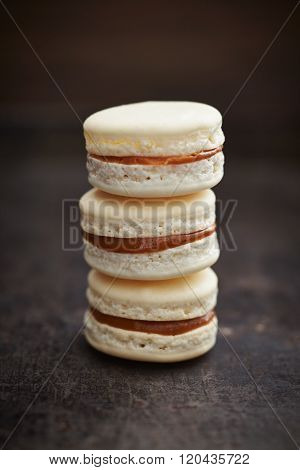 Three macarons with caramell filling