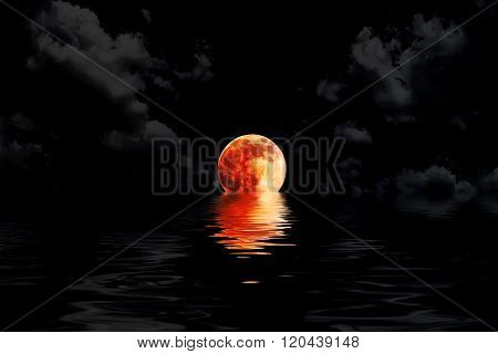 Dark red full moon in cloud with water reflection closeup showing the details of the lunar