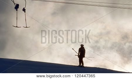 Silhouett Of A Ski Lift And And Skier In Evenling Light