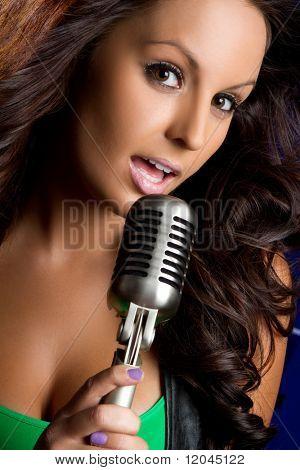 Beautiful vintage microphone girl singing