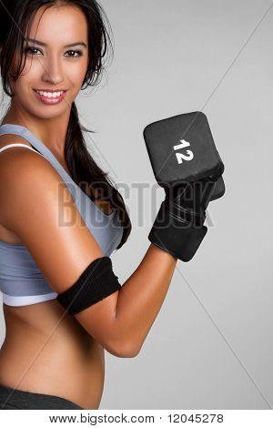 Fit exercising woman lifting weights