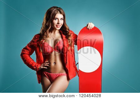Attravtive Young Sexy Girl With Nice Makeup Holding Red Snowboard On Winter Background. Space For Yo