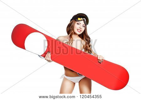 Sports Topless Girl In Swimsuit With Makeup Hold Snowboard Near Breast. Place For Logo. Studio Isola
