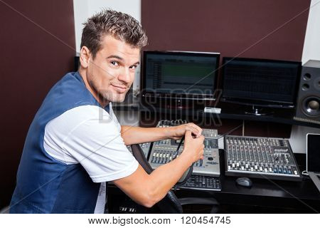 Portrait Of Confident Young Man Mixing Audio