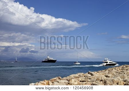 French Riviera coast with yachts, sailing boats