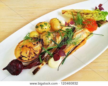 Gourmet Dish With Grilled Fish And Vegetables