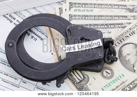 Handcuffs And Money With Sign – Cars Leasing On Tax Form Background