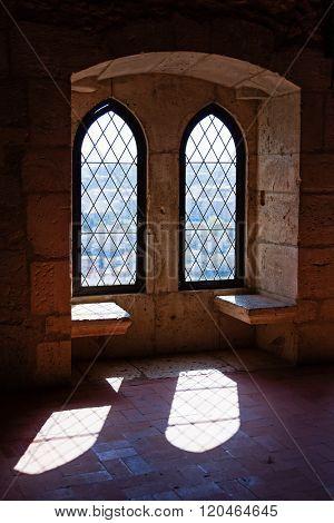 Gothic windows in the Palatial Residence (Pacos Novos) of the Leiria Caste. Leiria, Portugal.