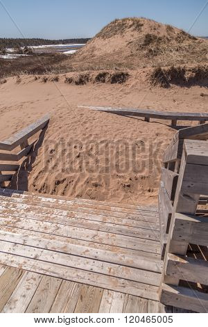 Piled Sand On Wooden Stairs