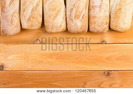 Crusty Fresh Bread Loaf Border On Wood
