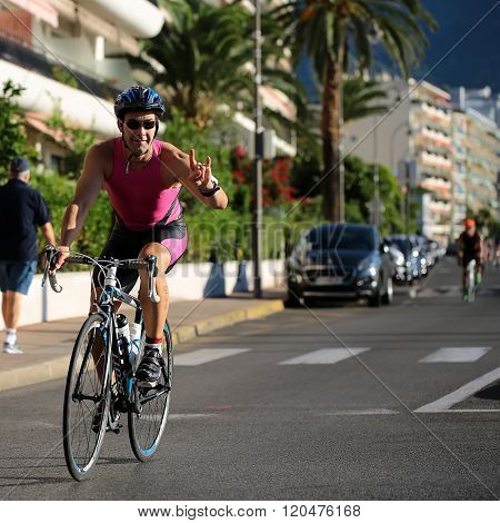 Cyclist Shows Devil Horns Gesture