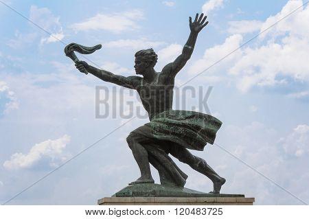 Statue Of A Torch Bearer
