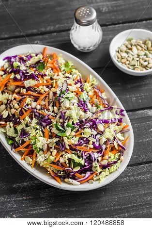Cole Slaw With Seeds And Pine Nuts - Delicious Healthy Vegetarian Food. On A Dark Rustic Wooden Back