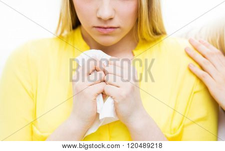 friendship, support, heartbreak and people concept - close up of crying teenage girl comforted by friend