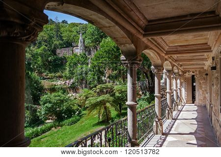 Sintra, Portugal - July 14, 2015: Balcony in the Regaleira Palace with a view of the Gardens. A neo-manueline palace decorated with alchemy and freemasons symbols.