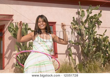 Young woman using a hula hoop