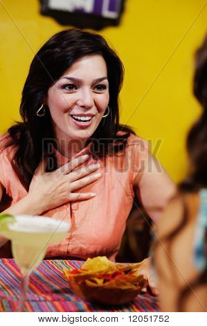 Woman talking to friend in restaurant