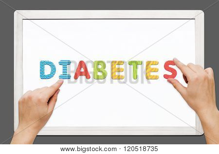 Hands Put The Word Diabetes With Magnetic Letters
