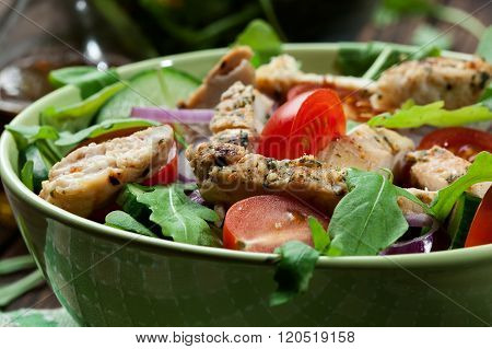 Fresh Salad With Chicken, Tomatoes And Arugula On Plate