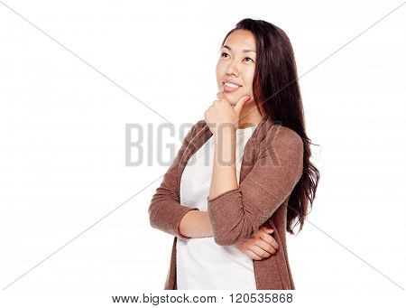 Young beautiful asian woman with long hair wearing brown cardigan, standing with hand on her chin, looking up and thinking isolated on white background - planning concept