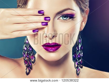 girl model with purple makeup and violet manicure on the nails