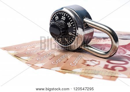 Combination lock and canadian bills on white background