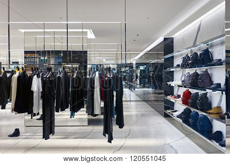 SINGAPORE - NOVEMBER 08, 2015: interior of  Yves Saint Laurent store. Saint Laurent Paris is a luxury fashion house founded by Yves Saint Laurent and his partner, Pierre Berge.