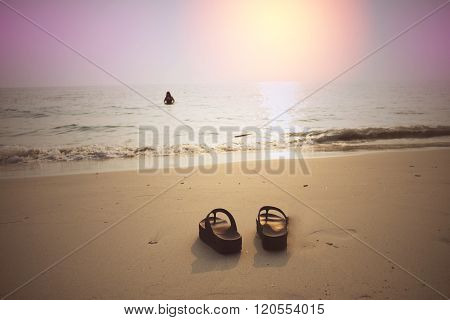 Sunset On The Beach With Woman Wear Swimming Suit