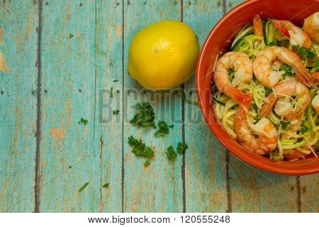 Spiralized Zucchini With Jumbo Shrimp On Wood Board